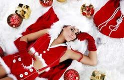 Meisje dat de kleren van de Kerstman draagt royalty-vrije stock afbeelding