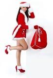 Meisje dat de kleren van de Kerstman draagt stock afbeeldingen