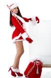 Meisje dat de kleren van de Kerstman draagt royalty-vrije stock fotografie