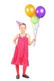 Meisje dat een bos van ballons houdt Stock Afbeeldingen