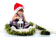 Meisje dat een hoed van de Kerstman draagt Stock Fotografie