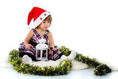 Meisje dat een hoed van de Kerstman draagt Royalty-vrije Stock Foto's