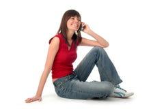 Meisje dat een mobiele telefoon met behulp van Stock Foto