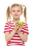 Meisje dat groene appel en het glimlachen eet stock foto's