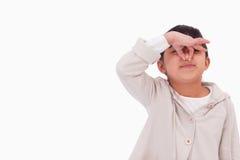 Meisje dat haar neus knijpt Stock Foto