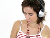 Meisje dat hoofdtelefoons draagt royalty-vrije stock fotografie