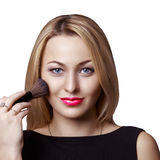 Meisje dat make-up doet Royalty-vrije Stock Afbeeldingen