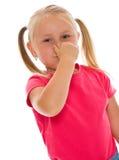 Meisje dat neus behandelt Stock Afbeeldingen