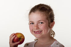 Meisje dat rode appel eet Royalty-vrije Stock Afbeelding