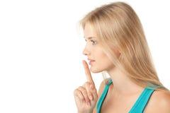 Meisje dat stilte vraagt te houden Stock Foto's