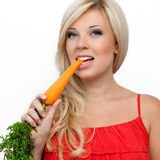 Meisje dat vitamine rijke wortel eet Royalty-vrije Stock Afbeelding