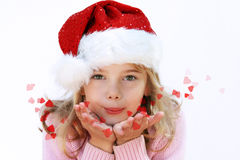 Meisje in de hoed van de Kerstman Stock Foto's