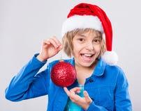 Meisje in de hoed van de Kerstman Stock Foto