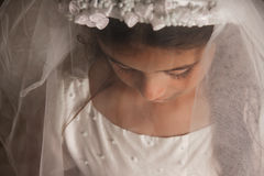 Meisje in de Kleding van de Heilige Communie met een sluier Stock Foto's