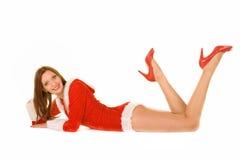 Meisje in de kleding van de Kerstman Stock Afbeeldingen