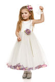 Meisje in de mooie klokken van de kledingsholding Stock Fotografie