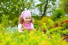 Meisje in de tuin Stock Afbeelding