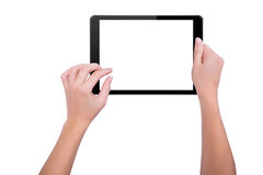 Meisje die aan een tablet werken Stock Foto's