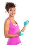 De jonge Vrouw heft Gewichten op Stock Fotografie