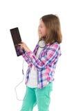 Meisje die een digitale tablet gebruiken Stock Foto