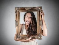 Meisje die een kader houden Stock Foto