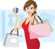 Meisje die met creditcard winkelen Stock Afbeeldingen
