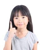 Meisje die met haar vinger benadrukken Stock Foto's