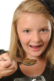 Meisje die muntstukken eten Royalty-vrije Stock Foto's