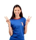 Meisje die overwinning voor Frankrijk ondertekenen Stock Foto's