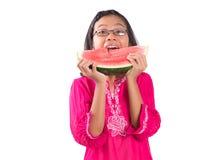 Meisje die Watermeloen II eten Stock Foto's