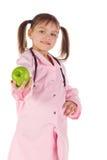 Meisje, een arts, het kind, appel Stock Foto