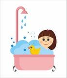 Meisje in een bad met rubbereend Stock Foto