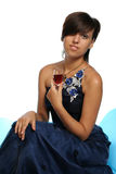 Meisje in een blauwe avondjurk Stock Fotografie