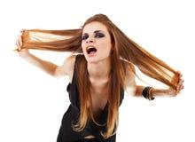Meisje in een donkere make-upschreeuwen Stock Fotografie