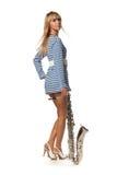 Meisje in een gestript vest met een saxofoon Royalty-vrije Stock Afbeelding