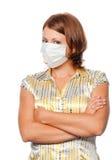 Meisje in een medisch masker stock foto's