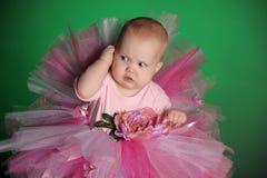Meisje in een roze pluizige rok Stock Fotografie