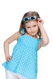 Meisje in een stip blauwe kleding Stock Foto