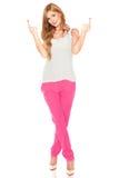 Meisje in een wit overhemd en een roze broek Stock Fotografie