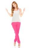 Meisje in een wit overhemd en een roze broek Royalty-vrije Stock Foto's