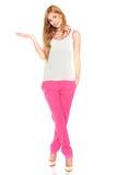 Meisje in een wit overhemd en een roze broek royalty-vrije stock afbeeldingen