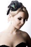 Meisje in een zwarte hoed Stock Foto