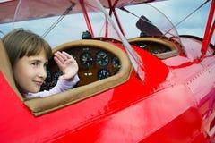 Meisje en airpalne Royalty-vrije Stock Afbeeldingen