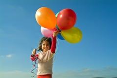 Meisje en baloons Stock Afbeelding