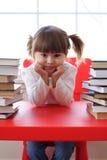 Meisje en boeken voor lezing Stock Fotografie