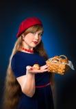 Meisje en croissant Stock Afbeeldingen