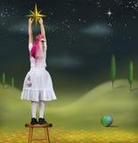 Meisje en de ster van Kerstmis Royalty-vrije Stock Afbeelding