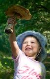 Meisje en een paddestoel Royalty-vrije Stock Foto's