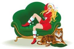 Meisje en een tijger op de vooravond van Kerstmis Stock Foto