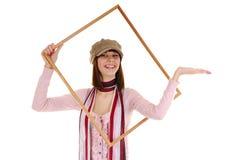 Meisje en frame Stock Afbeeldingen